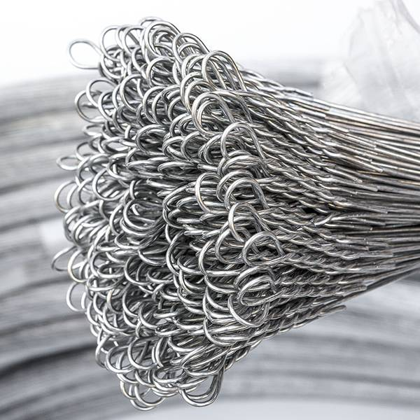 A roll of single loop bale ties on the gray background.