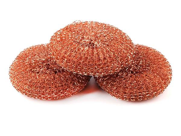 Several pieces of copper scourers on white background.