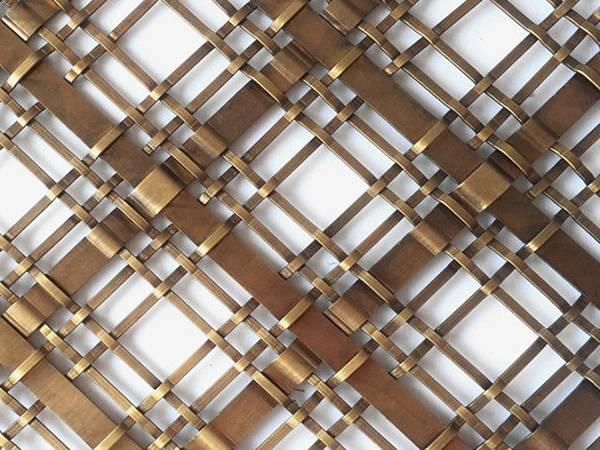 A piece of decorative mesh is made of flat shaped wire.