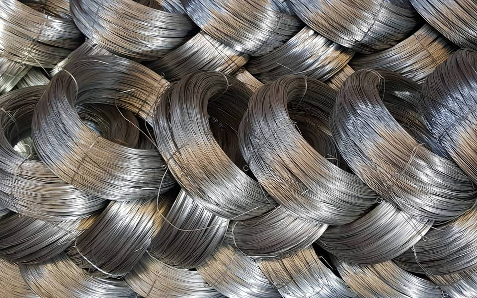 Several rolls of galvanized binding wires.