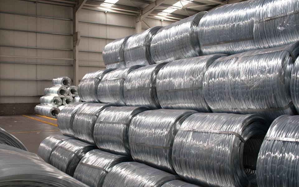 Several rolls of galvanized steel wire rolls in the warehouse.