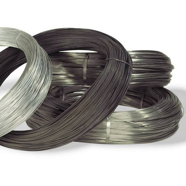 Several rolls of different materials of steel wires on white background.