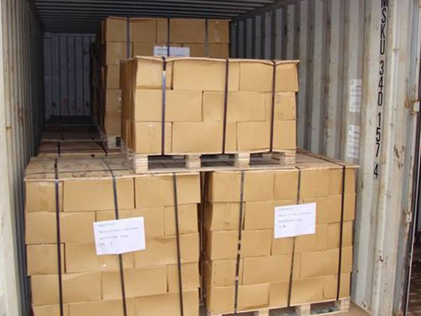Several pallets of scourer wires in the container.
