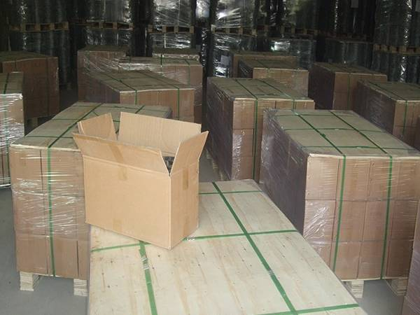 Several pallets of scourer wires in the warehouse.