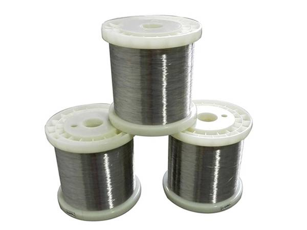 Three rolls of round scourer wires on white background.