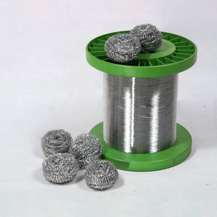 Several sourer wires are placed on a spool of stainless steel scourer wire.