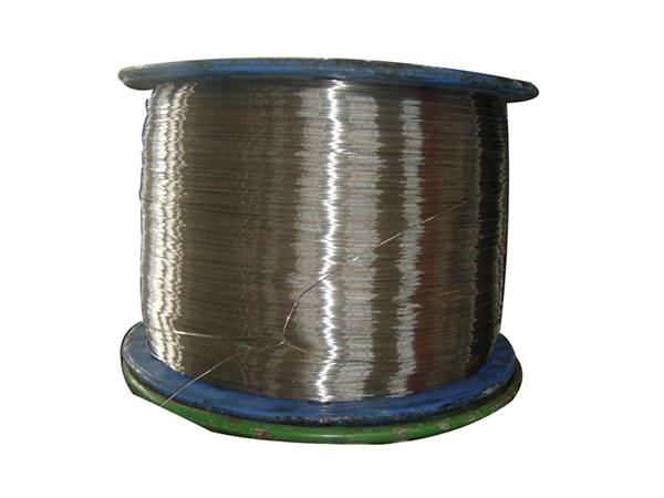 A roll of stainless steel scourer wire on white background.