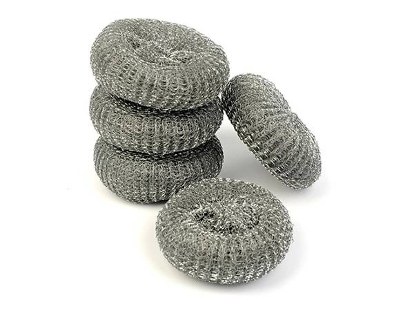 Several pieces of stainless steel scourers on white background.